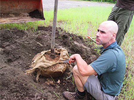 Jim demonstrates the proper way to plant a B&B tree.