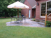 Native perennial gardens, and flag stone patio. Florence (Northampton), MA