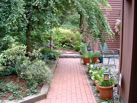 This brick walkway was originally installed 20 years before Jim McSweeney and the Hilltown Tree & Garden crew brought a new patio and landscape design to the home. It was damaged by frost heave and was reset as picture here.